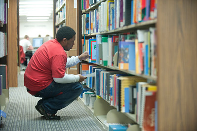 Student Assistant looking for a book in the ERC Stack.